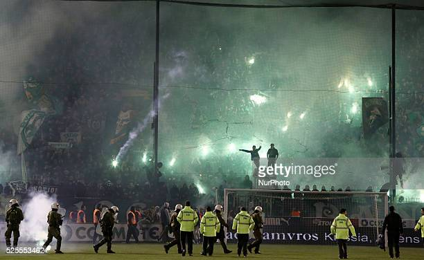 Clashes between riot police and PAO FC football fans inside the stadium after the referee's decision to postpone the match in Athens on November 21...