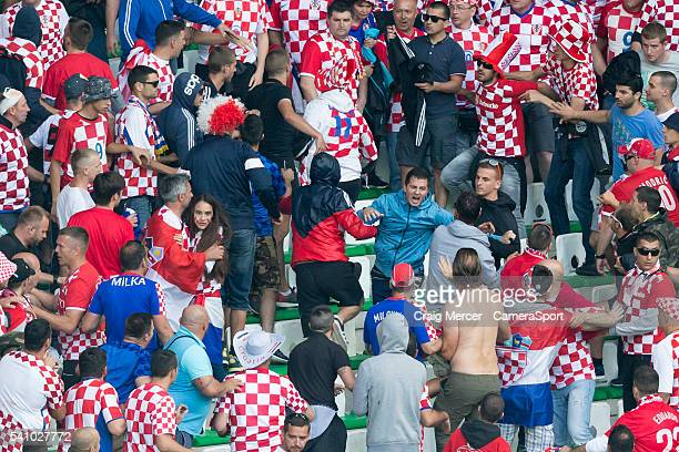 Clashes break out between fans in the Croatia supporters end during the UEFA Euro 2016 Group D match between Czech Republic and Croatia at Stade...