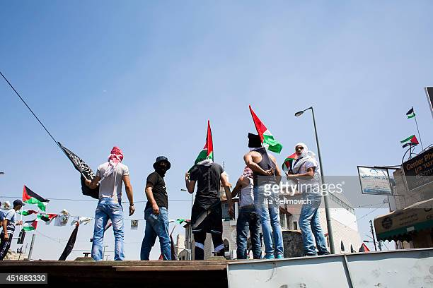 Clashes break out between Israeli police and Palestinian youths during the noon Ramadan prayer in Ras Al Amud neighbourhood ahead of the funeral...
