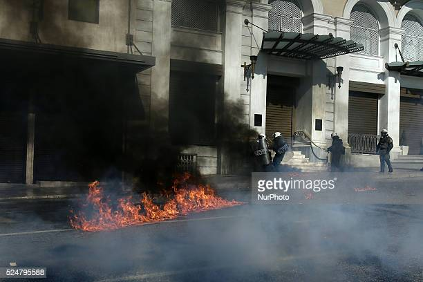 Clashes broke out in central Athens between riot police and protesters after the protest rally during the first 24hour general strike called by the...