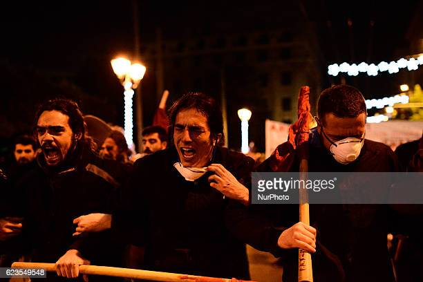 Clashes erupt between protesters and police during a demonstration in central Athens against US president Obama visit in Greece on November 15 2016