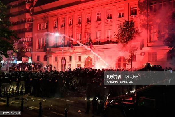 Clashes erupt in central Belgrade on July 8, 2020 between police and demonstrators against a weekend curfew announced to combat a resurgence of...