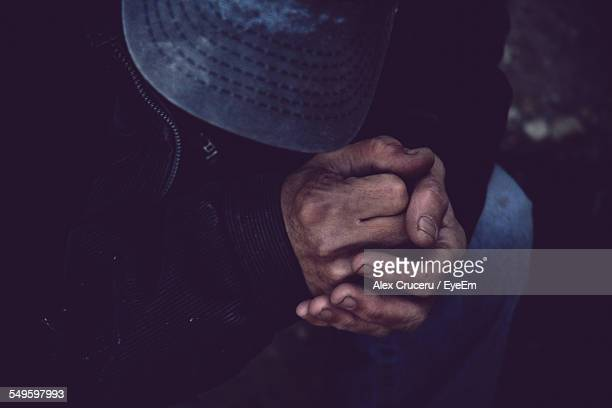 Clasped Hands Of Man