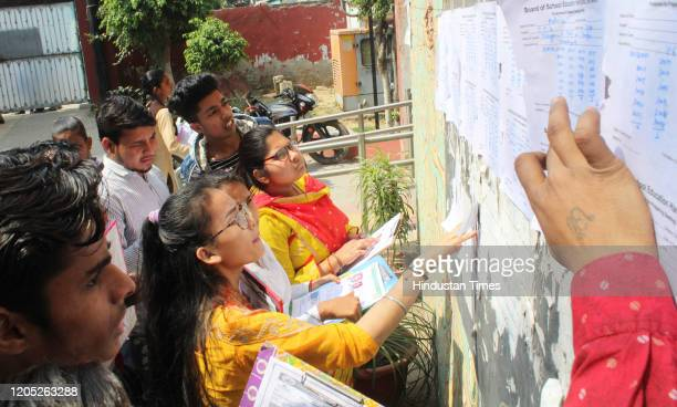 Class 10th students check their names on a list before entering an examination centre during the Social Science Haryana Board exam, at Government...