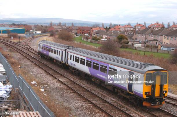 Class 156 Sprinter DMU trainset, in new Northern Trains lilac livery, approaches Morecambe with a Lancaster - Heysham Port service. March 2005.
