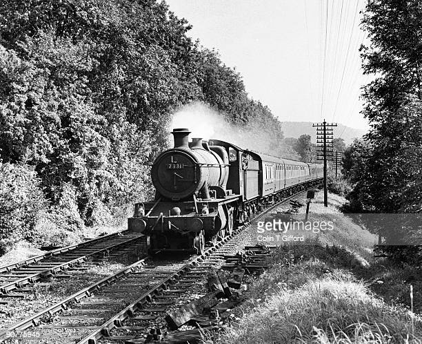 Class 2-6-0 No 7331 heads a passenger train beside the north downs near Betchworth. Photograph by Colin T Gifford.