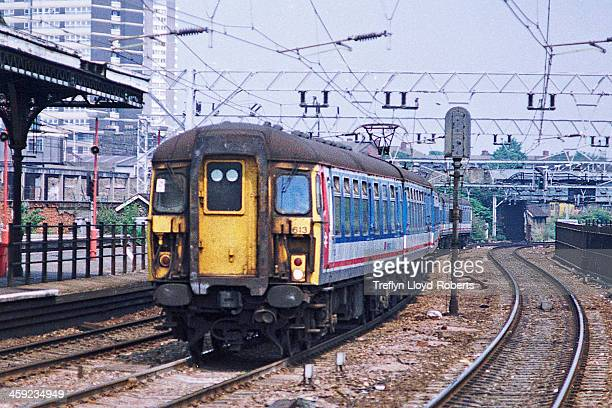 CONTENT] Class 309 Electric Multiple Unit train 309613 passsing Stratford Station East London 25th July 1989
