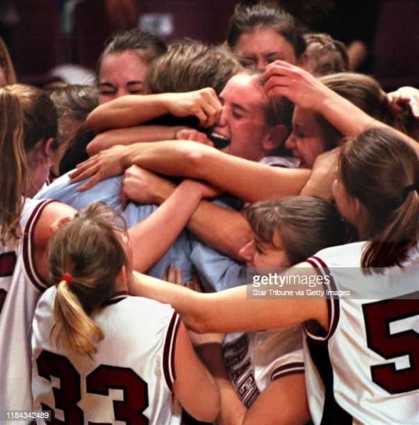 Class 3A girls' baskeball championship game Minneapolis North Polars vs New Prague New Prague head girls basketball coach Ron Gunderson is hugged by...