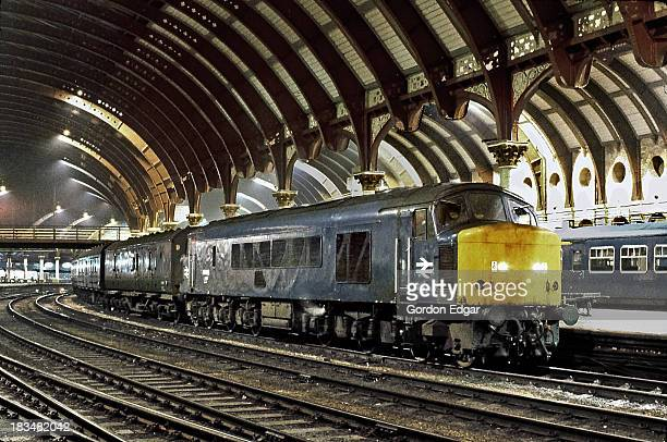 Class 46 'Peak' No.46045 heading a down parcels service in the early hours at York on 26th July 1980. Fifty-six class 46 locomotives were built at...