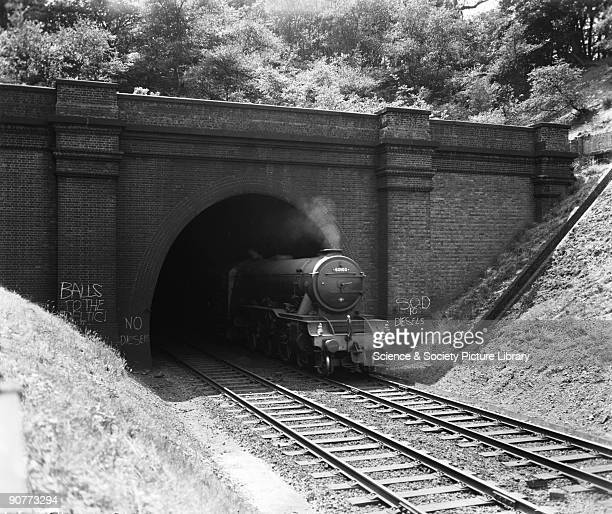 A3 class 462 locomotive number 60103 'Flying Scotsman' with a passenger train emerging from Welwyn North Tunnel Hertfordshire 20 July 1959 The tunnel...