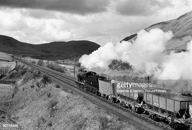 Class 4F goods steam locomotive No 44292 with a train of empty hopper wagons passing through Lune Valley Photograph by Bishop Eric Treacy Treacy was...