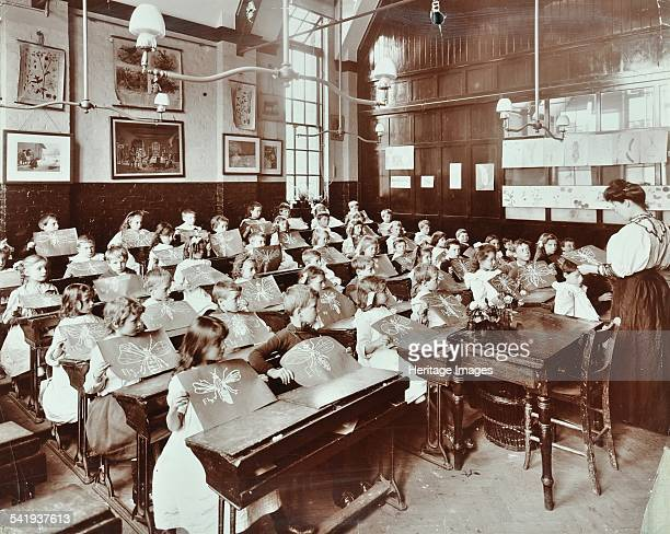 Class 5 Goodrich Road School Camberwell London 1907 The children of Class 5 hold up freehand drawings they have made of a fly Artist unknown