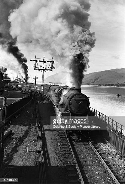 Class 5 steam locomotive No 45499 on the banks of Loch Linnhe near Fort William heading for Glasgow c 1950s Photograph by Bishop Eric Treacy Treacy...