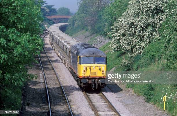 A Class 56 diesel electric at the head of an agregate train passes milepost 92_ on the Midland Main Line circa 1993