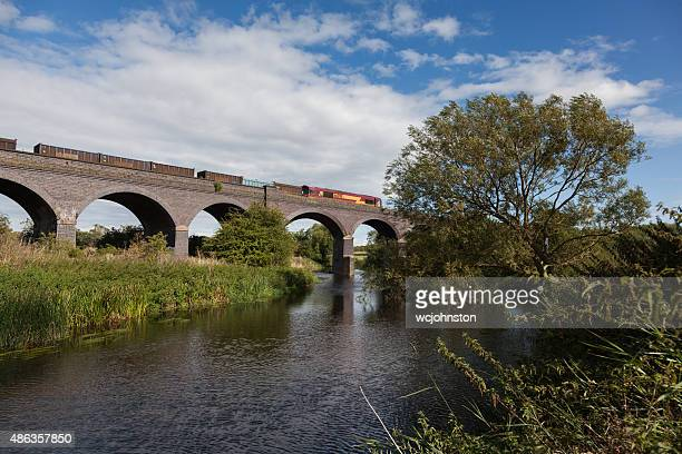 Class 66 locomotive freight train crosses the viaduct