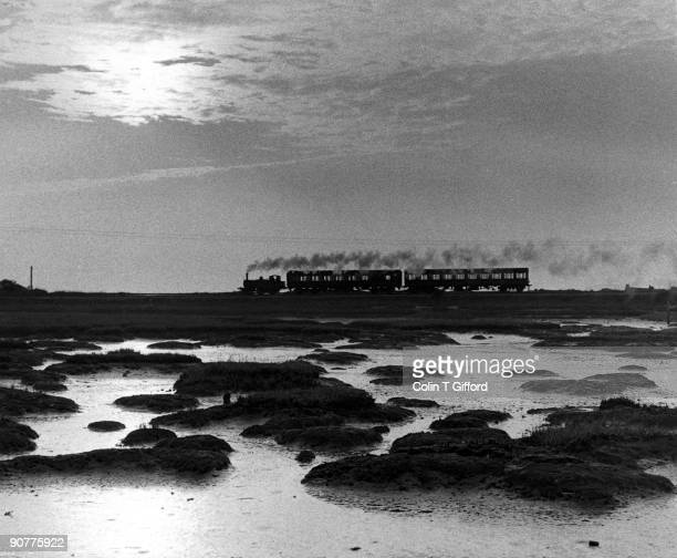 Class A1X 0-6-0T No.32661 crosses Langston Harbour causeway with an evening Havant-Hayling Island train on 9 September 1960. Photograph by Colin T...