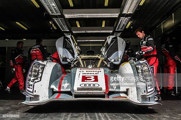 LMP1 class Audi Sport Team Joest Audi R18 etron quattro of Marc Gene / Lucas Di Grassi / Oliver Jarvis in the garage during Free Practice 1 at Round...