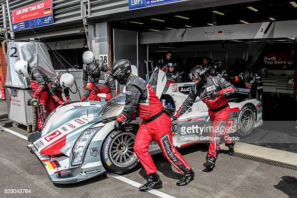 Class Audi Sport Team Joest Audi R18 e-tron quattro of Marc Gene / Lucas Di Grassi / Oliver Jarvis , is pushed out of the box by the Audi mechanics...