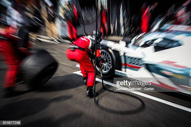Class Audi Sport Team Joest Audi R18 e-tron quattro tire change by mechanics in the pit-lane during Free Practice 2 at Round 2 of the FIA World...