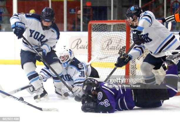 Class B State Championship hockey game Joseph Graziano of York tries to clear the puck after Keenan Gamache made a save on a shot by Cody Pellerin of...