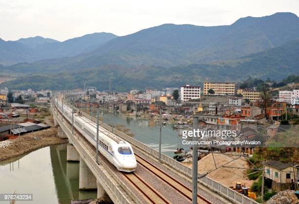 CRH 2 class electric multiple unit crosses the Feiwan viaduct on the Ningbo Wenzhou Fuzhou High Speed line China 18th February 2010 18th February 2010
