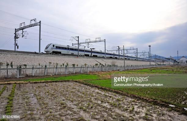 Class electric multiple unit leaves Yandangshan railway station on the Ningbo - Wenzhou - Fuzhou High Speed line, China. 17th February 2010, 17th...