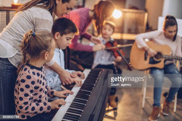 class in music school - keyboard player stock photos and pictures