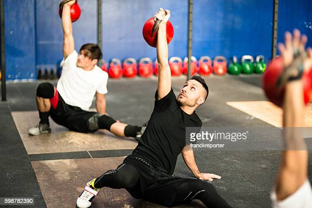 class lifting a kettlebell - sports equipment stock pictures, royalty-free photos & images