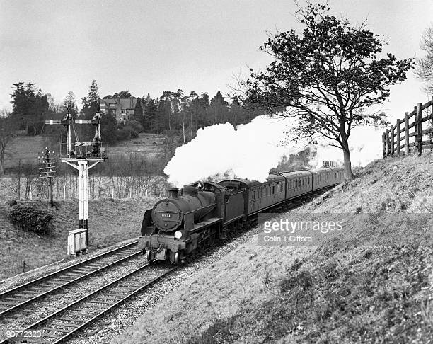 Class N 2-6-0 no 31851 heads a Tonbridge-Brighton train at Birchden Junction on the Sussex/Kent border. Photograph by Colin T Gifford.