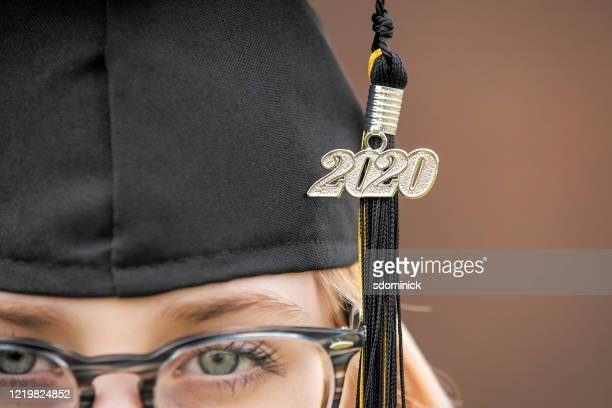 class of 2020 tassel and cap close up on girl - tassel stock pictures, royalty-free photos & images