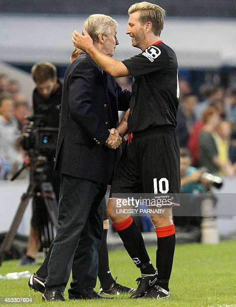 Class of 92 Friends Welsh former midfielder Robbie Savage embraces team manager Eric Harrison after being substitutedoff during the preseason...