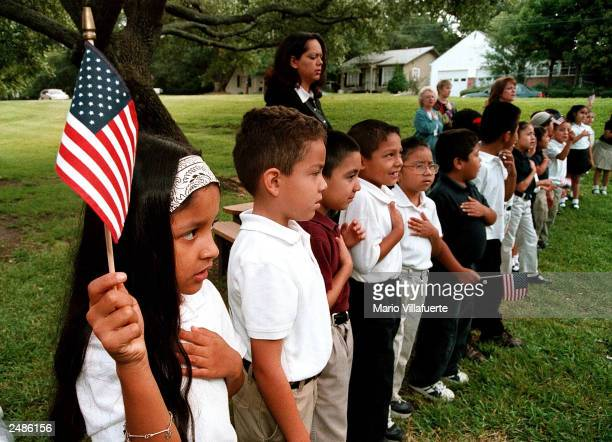 A class of Hispanic students recites the Pledge of Allegiance during a September 11 memorial service at Birdwell Elementary School September 11 2003...