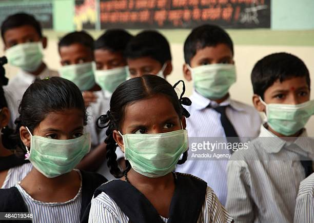 A class of Indian students have taken to wearing masks to avoid contracting swine flu in Mumbai India on 20 February 2015 Forty more deaths due to...