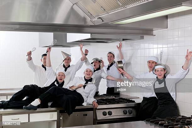 class photo of cheering chef students in kitchen - class photo stock photos and pictures