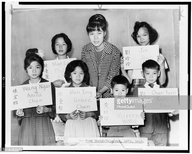 Class portrait of teacher April Lou and her students at Manhattan's PS 1, New York, New York, 1964. The students, all recent immigrants from Hong...