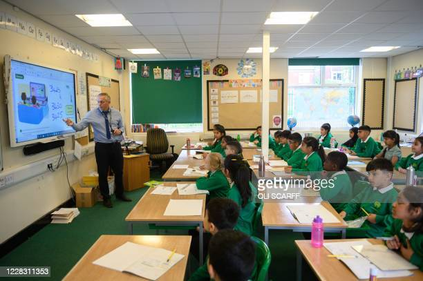 Class teacher David Dean leads a maths class for Year Five pupils at Greenacres Primary Academy in Oldham northern England on September 02 2020...