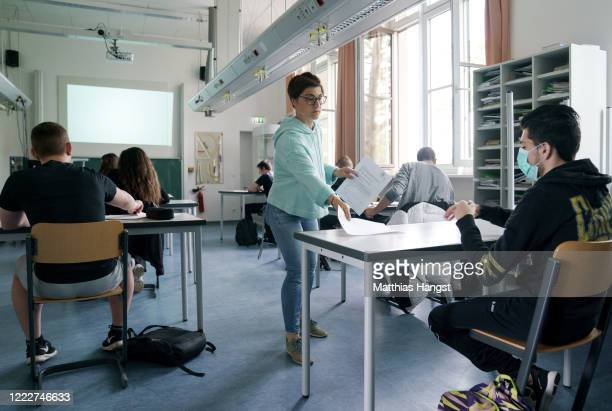 Class teacher Katharina Schneider welcomes back a group of tenth graders who will soon face exams at the Schillerschule school during the novel...