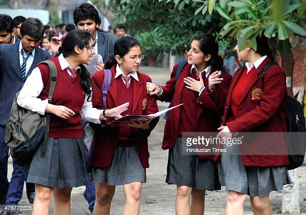 Class XII students coming out after appearing for their English language paper during Central Board of School Education examinations on March 1, 2014...