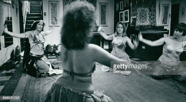 Classes Stress Folk Aspect Of Art Of Belly Dancing Which Originated ***** Lia Johnson teacher with back to camera students are from left Sue Hovland...