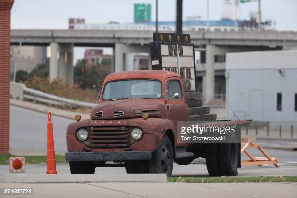 Classic 1948 Ford F-1 pickup truck stationed in downtown Buffalo holds up a marquee sign before the Buffalo Bills NFL game against the New Orleans...