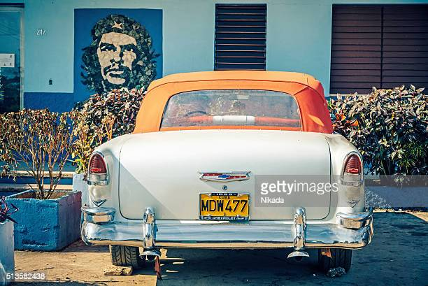 Classic American Car parked in front of Che picture