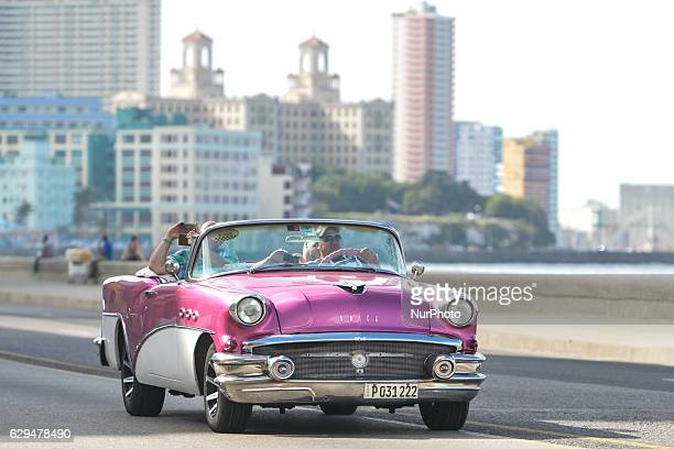 A classic American car used as a private taxi seen in Malecon area of HavanaThousands of vintage American cars remain scattered throughout Cuba...