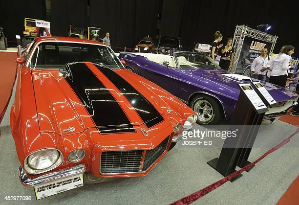 Classic American Muscle cars are displayed during the Lebanon Motorsport and Tuning Show 2014 in Jounieh north of Beirut on July 31 2014 The show...