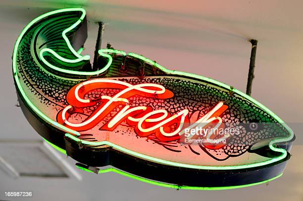 classic americana neon fresh fish shaped sign - vintage restaurant stock pictures, royalty-free photos & images