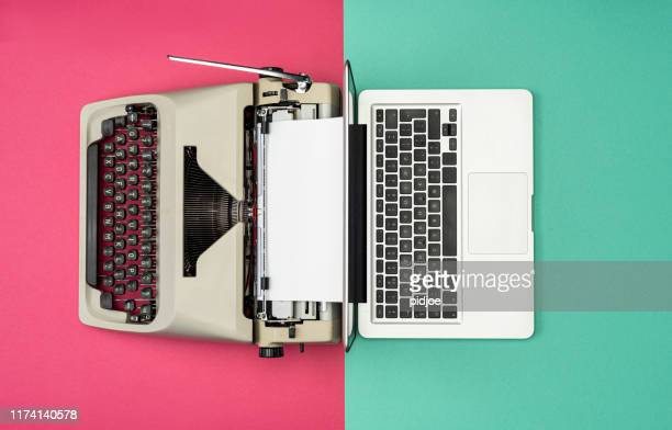 classic analog typewriter vs modern digital hi-tech laptop computer - the past stock pictures, royalty-free photos & images