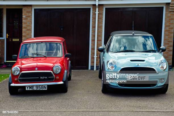 classic and bmw mini coopers - mini cooper stock photos and pictures