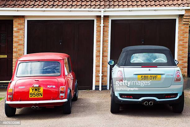 classic and bmw minis - two objects stock photos and pictures