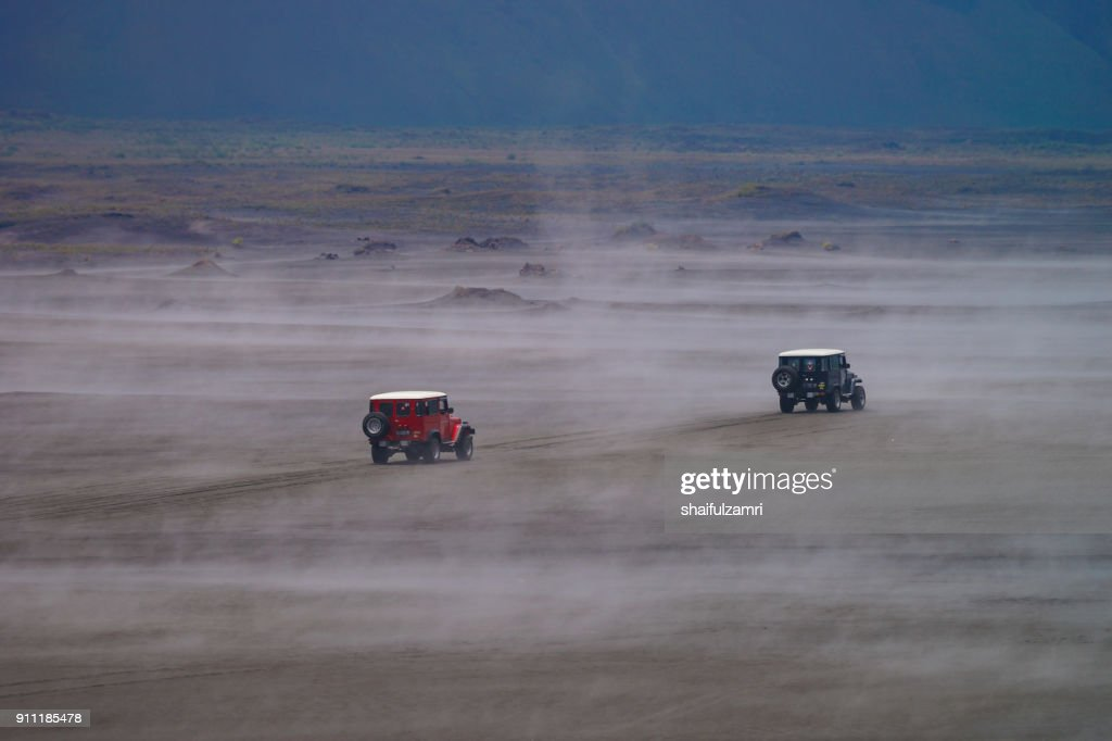 A classic and easiest way to do Bromo Tengger Semeru National Park was by jeep ride. Just sit on jeep and even sleep along the way go - from the most stunning sunrise sightseeing at Penanjakan or roaming the misty fog at Pasir Berbisik. : Stock Photo