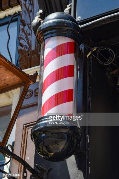 Classic barbers pole outside of a Barbers shop.