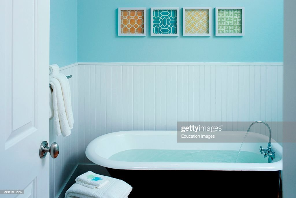 Classic bathtub filled with water Pictures | Getty Images